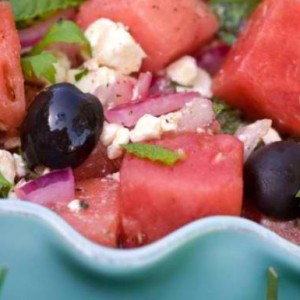 Feta salad with watermelon, red onion, tomatoes and green lettuce with a spicy pepper dressing
