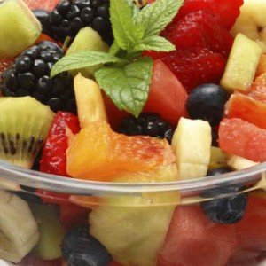 Fruit salad of melon, strawberries and kiwi