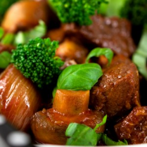 Modern veal stew with onion and broccoli