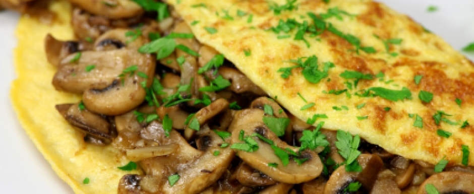Omelette with fried onion, mushrooms and chives